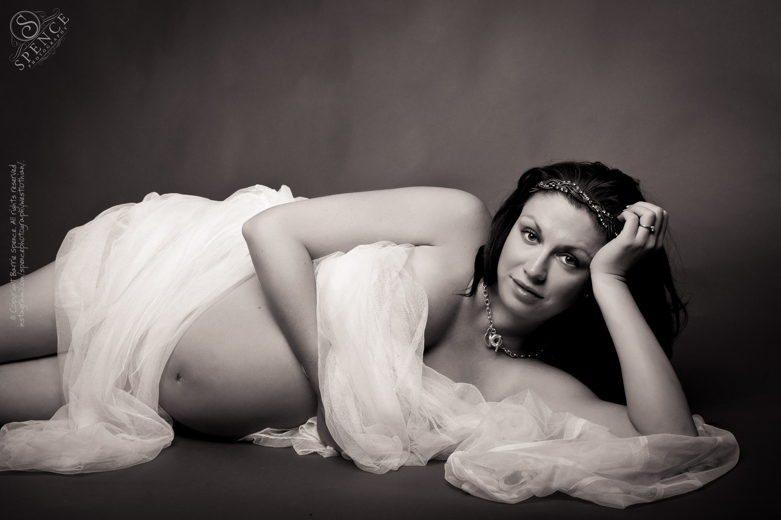 Mater­nity pho­to­graphy — Tracy at week 31 of her preg­nancy (with twins) shot in our West Lothian studio.