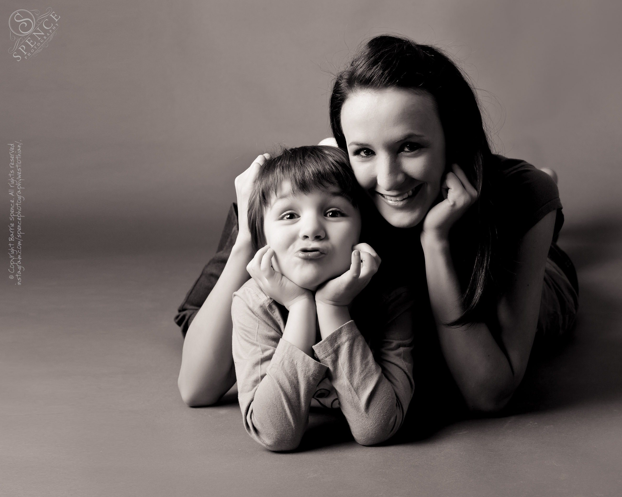 Fam­ily pho­to­graphy — Desiree and Kai (mother and son) taken in our Liv­ing­ston studio.