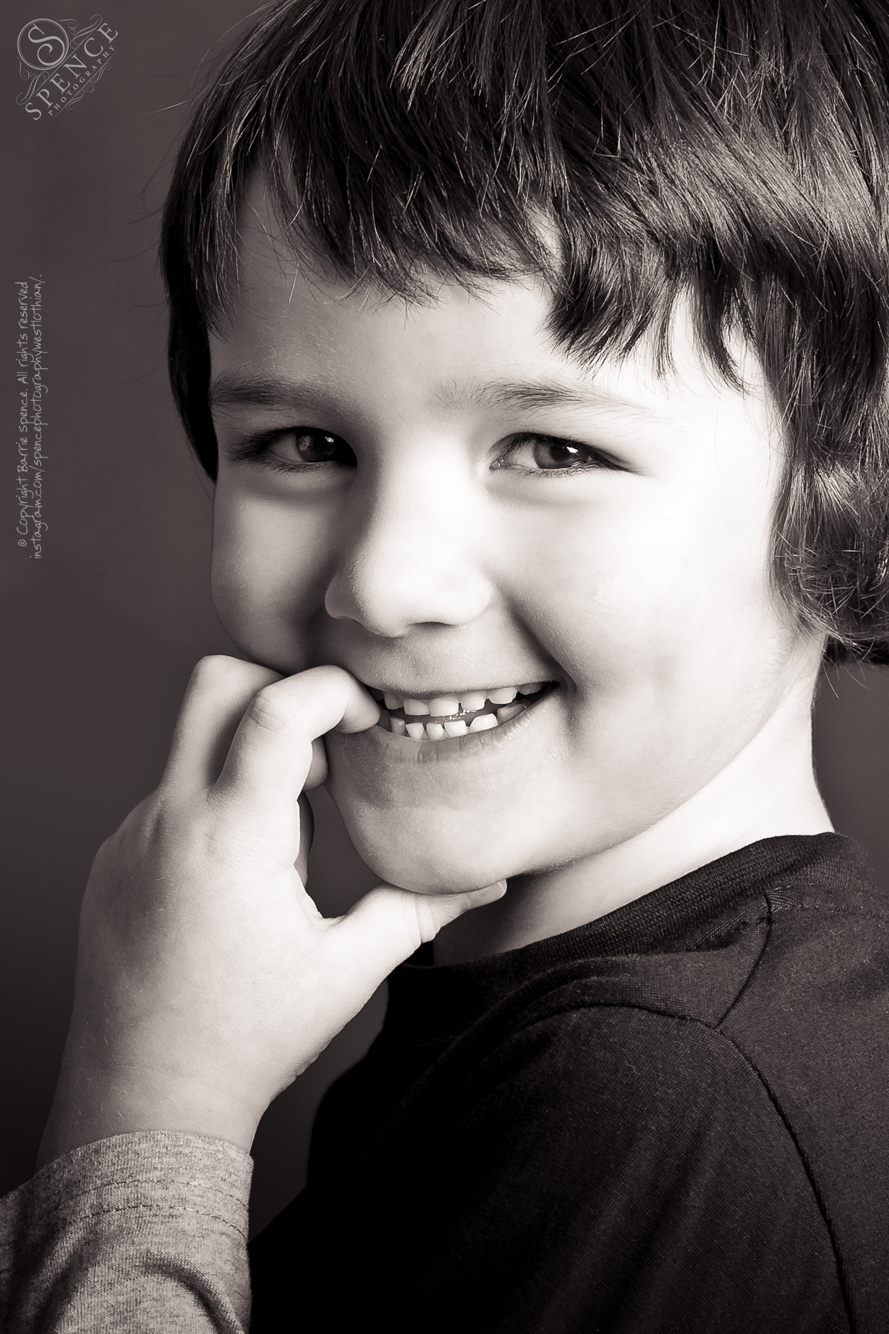 Children's pho­to­graphy — black and white stu­dio por­trait of Kai taken in our Liv­ing­ston studio.